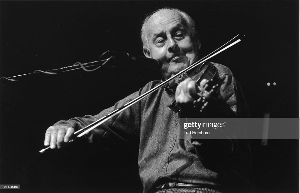 French jazz musician Stephane Grappelli (1908-1997) plays a violin on stage for Da Camera Society at the Wurtham Theater in Houston, Texas.