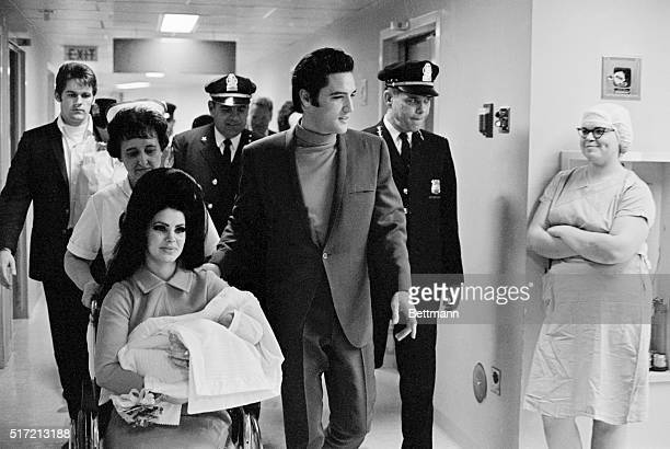 Evis Presley with his wife and daughter as they leave Baptist Hospital