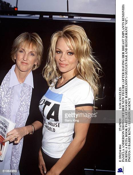 E 350234 004 27Apr99 Los Angeles Pamela Anderson Shows Off Her New Figure During A Peta Book Party At Woody Harrelson's Oxygen Bar And Restaurant...