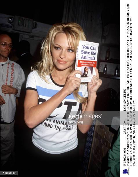 E 350234 006 27Apr99 Los Angeles Pamela Anderson Shows Off Her New Figure During A Peta Book Party At Woody Harrelson's Oxygen Bar And Restaurant...