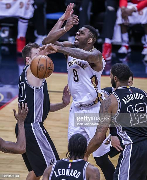 New Orleans Pelicans guard Langston Galloway blocks the ball against New Orleans Pelicans forward Terrence Jones during the game between the New...