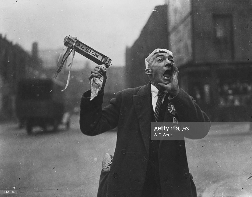 A West Bromwich Albion FC fan waves his rattle and cheers as he makes his way to Wembley Stadium for the FA Cup final between West Bromwich Albion...