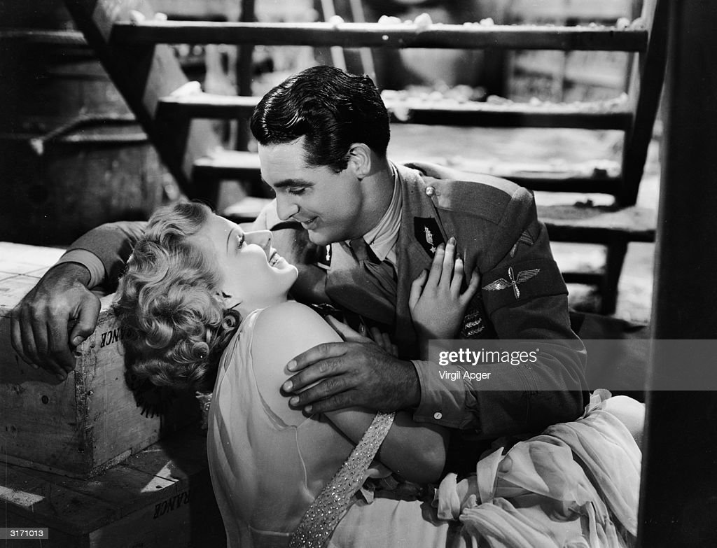 Jean Harlow and Cary Grant (1904 - 1986) in a scene from 'Suzy' directed by George Fitzmaurice for MGM.