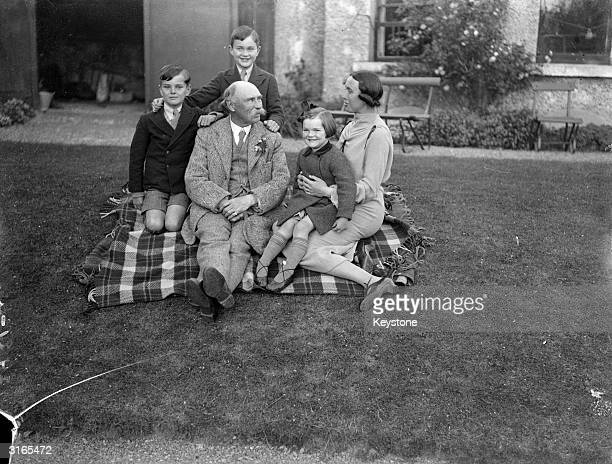 Dr Douglas Hyde the Presidentelect of Eire with his daughter Mrs Sealy wife of Judge J Sealy and her children at her home in Donnybrook Dublin