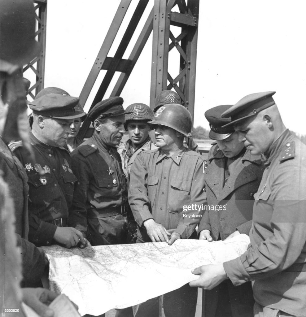 Russian and American troops meet up on the River Elbe at Torgau in Germany.