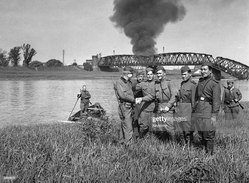 Russian and American troops meet up on the River Elbe.