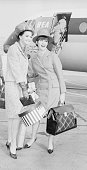 Air hostesses Penny Gillard and Jackie Bowyer prepare to board a BEA passenger plane for Paris
