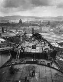 The new Cunard White Star liner '534' later the Queen Mary during its construction at the John Brown Co shipyard Clydebank The Singer factory can be...