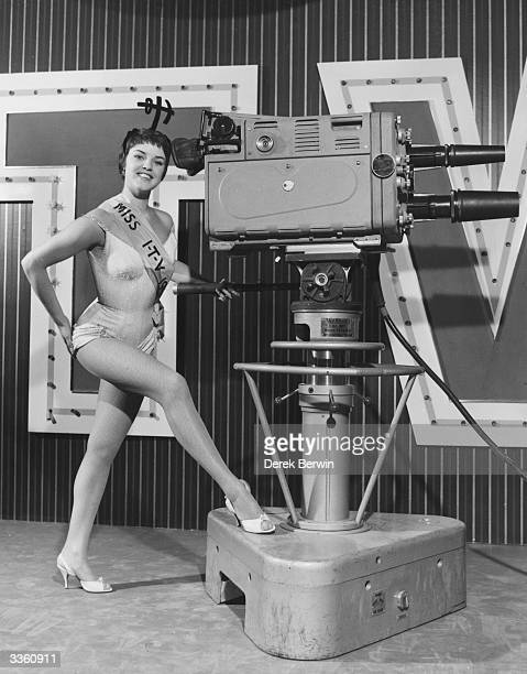 Miss Independent Television 1957 Deirdre Ottewell posing with a television camera during the preview day of the National Radio Show at Earls Court...