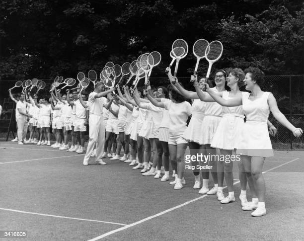 John Crooke a registered professional Lawn Tennis Association coach giving advice to keen players attending a Course and Coaching holiday held at...