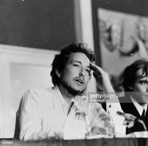 American folk rock singer Bob Dylan giving a press conference at his hotel during the Isle of Wight Festival