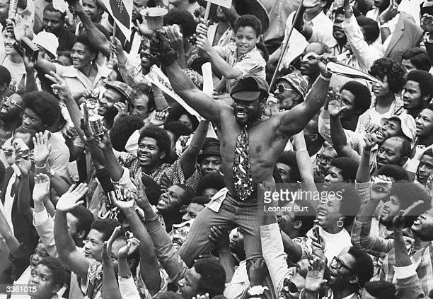 Fans of the West Indies cricket team celebrate their win over England at Lord's cricket ground London