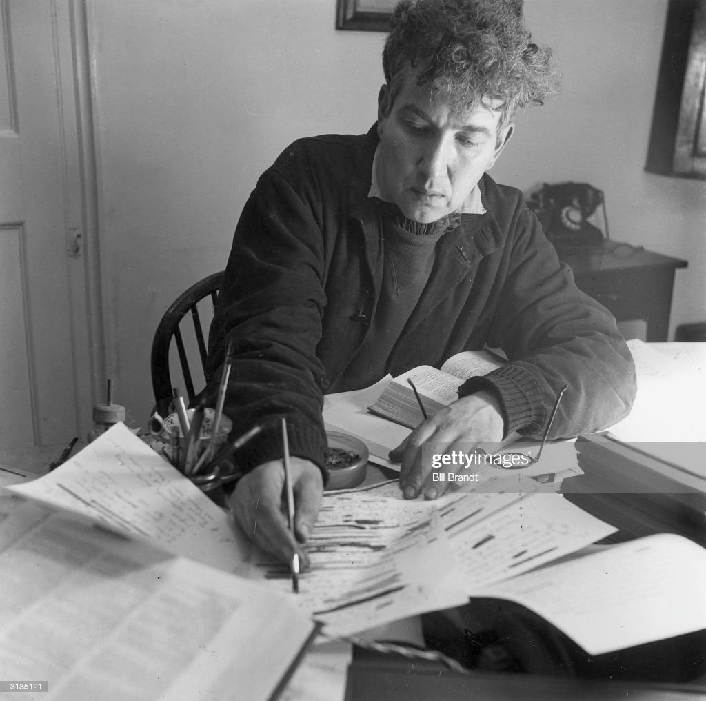 English novelist and poet, Robert Graves, writing at his home. Original Publication: Picture Post - 982 - What I Believe About Ghosts - pub. 1941