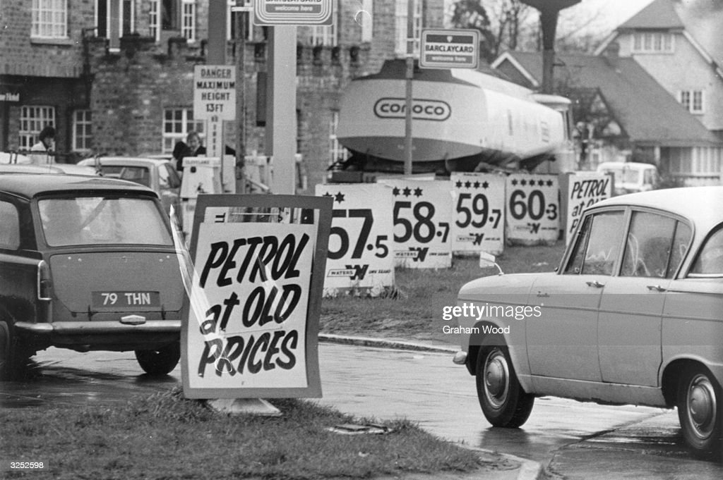 'Waters' garage on the A1 road at Hatfield selling petrol at the old price. Cars are queuing to fill their tanks.