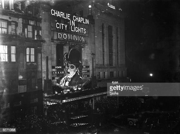 Crowds gather outside London's Dominion cinema on the opening night of the Charlie Chaplin film 'City Lights'