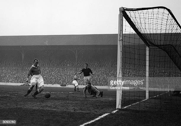 Scottish centre forward Hughie Gallacher scoring the first goal for Chelsea against Liverpool at Anfield