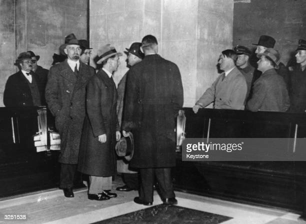 Adolf Hitler Joseph Goebbels and Hermann Goering inspect the damage caused by a fire at the Reichstag in Berlin