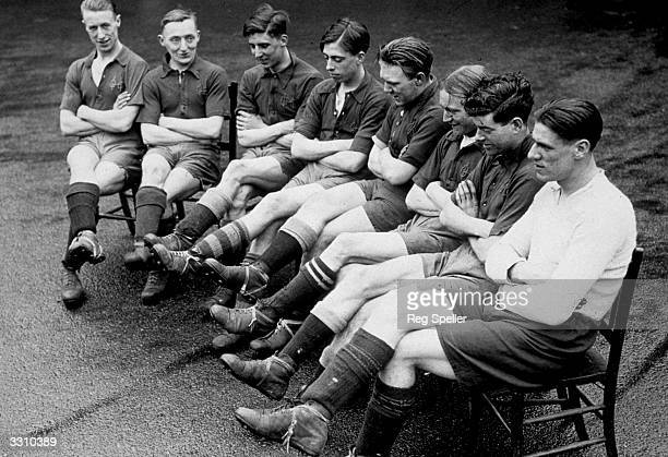 Some of the members of Oval House football team wearing the boots which the Prince of Wales donated to the club