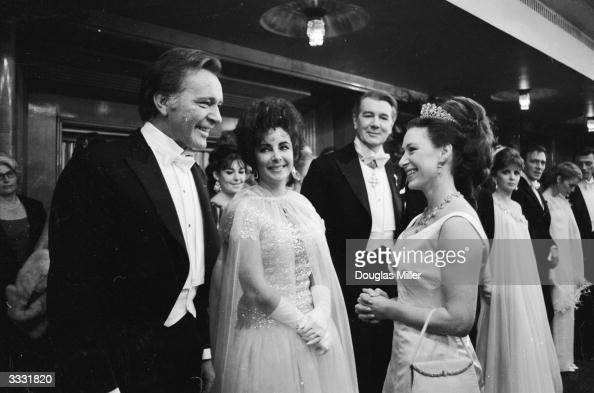 Princess Margaret chatting to Richard Burton and his wife Elizabeth Taylor with Sir Michael Redgrave behind them at the 1967 Royal Film Performance...