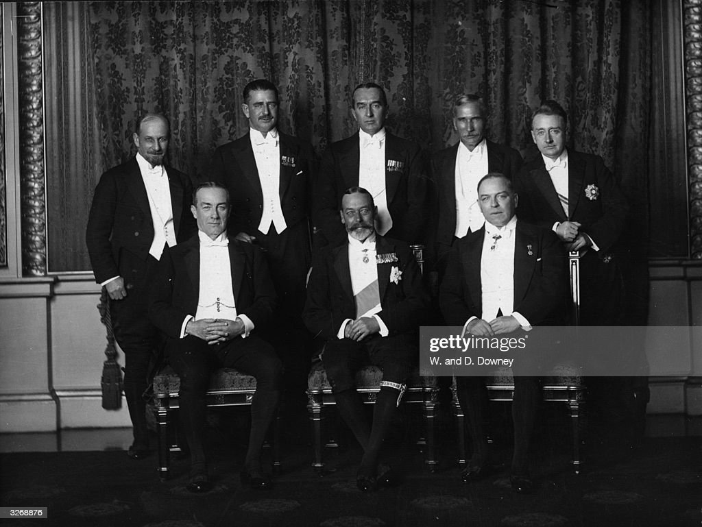 The Commonwealth Premiers and the Prime Minister, Stanley Baldwin (1867 - 1947) with King George V (1865 - 1936). The King is wearing The Garter on his leg.