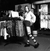 A teenager wearing hot pants and striped knee length socks