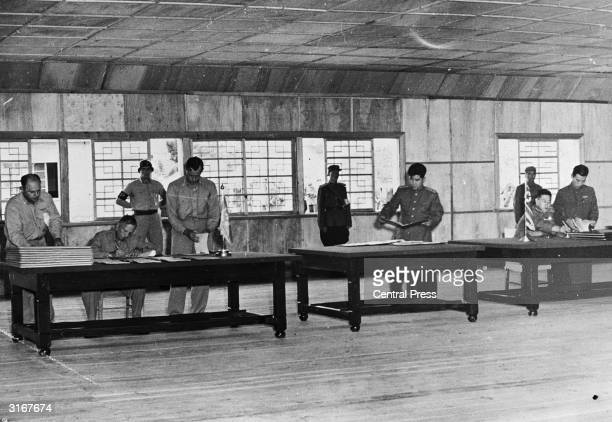 Lieutenant General William K Harrison and Senior Communist Delegate General Nam Il during the signing of the Korean Armistice at the truce village of...