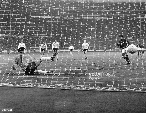 England goalkeeper Gordon Banks goes the wrong way as Portuguese star Eusebio scores from a penalty giving Portugal their only goal in the World Cup...