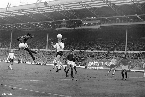 Eusebio of Portugal and Nobby Stiles of England in a duel for the ball during their World Cup semifinal match at Wembley which England won 21