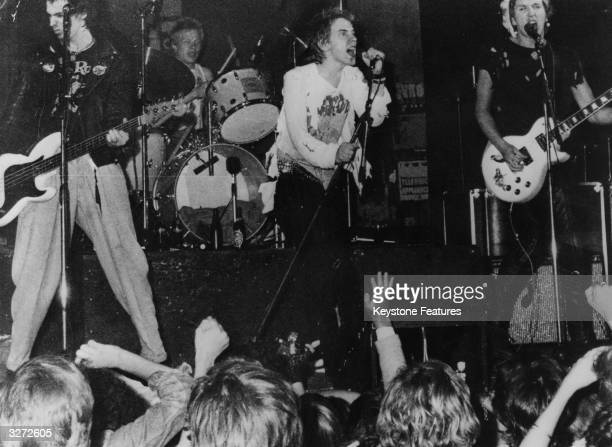 Infamous British punk rock group The Sex Pistols playing live in Copenhagen From left to right Sid Vicious Paul Cook Johnny Rotten and Steve Jones