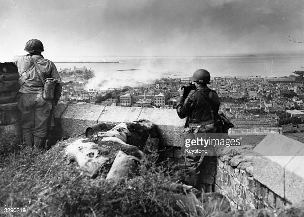 Military observers on the top of a hill overlooking the city of Cherbourg and the harbour