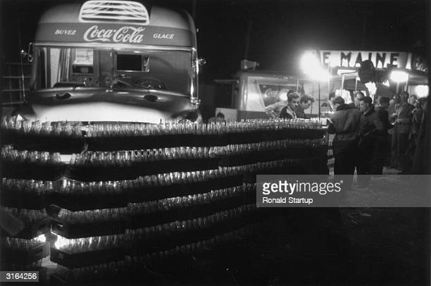 CocaCola bottles stacked outside a mobile bar during the 24hour race at Le Mans British driving teams Tony Rolt and Duncan Hamilton Stirling Moss and...