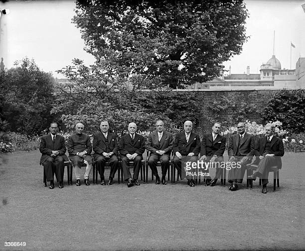 The prime ministers of the Commonwealth attend a meeting at Number 10 Downing Street London From left to right they are Solomon West Ridgeway Dias...