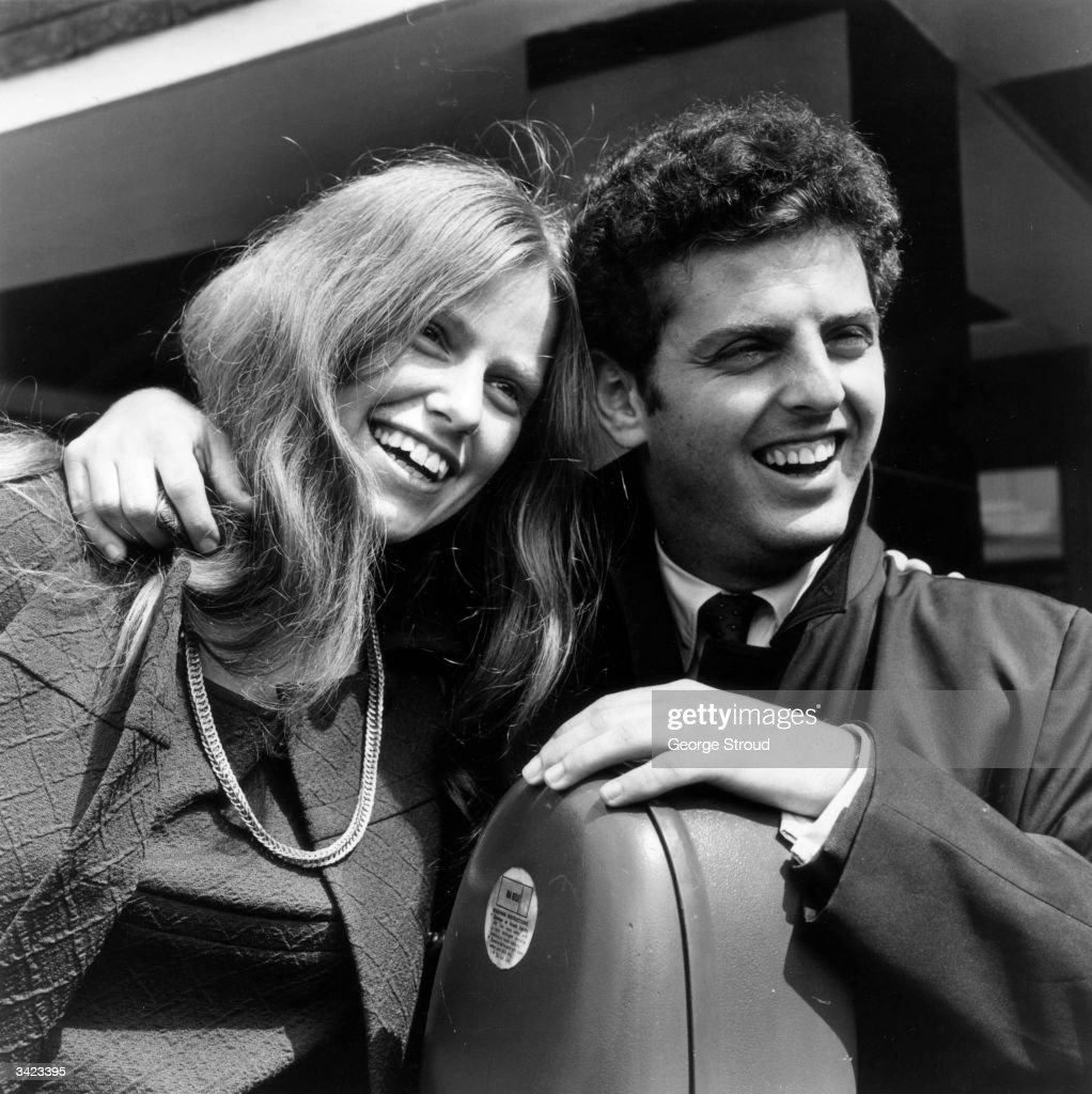 English cellist Jacqueline Du Pre (1945 - 1987) with her husband pianist <a gi-track='captionPersonalityLinkClicked' href=/galleries/search?phrase=Daniel+Barenboim&family=editorial&specificpeople=242823 ng-click='$event.stopPropagation()'>Daniel Barenboim</a> return to London after their marriage in Israel. Developing multiple schlerosis in 1972, Du Pre continued to teach for as long as her failing health would allow.