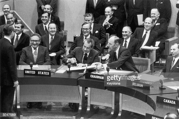 President Nixon signs NATO's new Declaration of Atlantic Principles following the summit meeting in Brussels To the left of Nixon is the US Secretary...