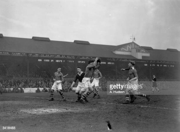 Huddersfield Town's goalkeeper Hesford collects the ball as Chelsea play Huddersfield Town