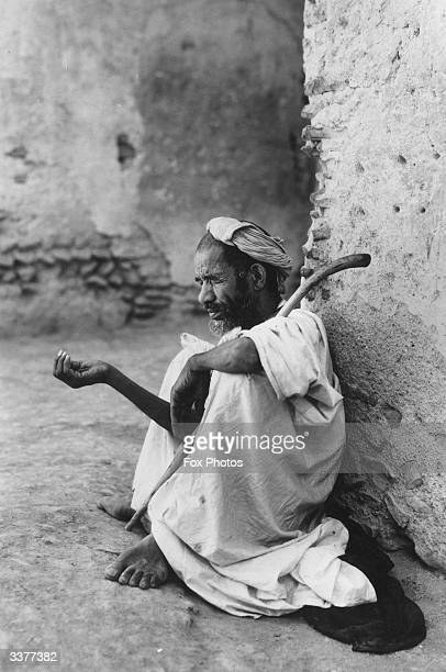 A blind beggar in the city of Fez in Morocco