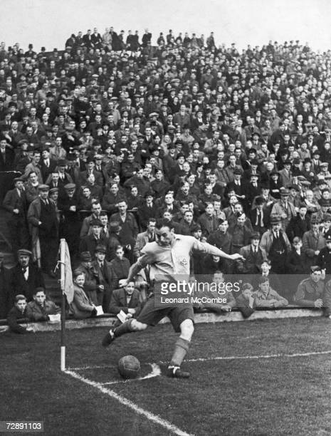 Star football player and RAF corporal Stanley Matthews taking a corner during a match with the RAF team Original Publication Picture Post 1401 The...