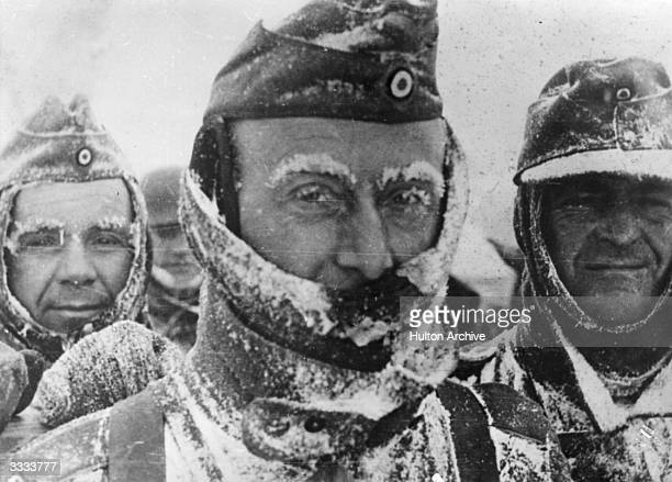 Three German soldiers covered in snow and ice during winter on the Eastern front