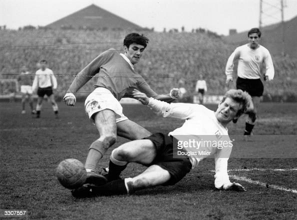 Keetch of Fulham slides to block a shot by George Best of Manchester United during their match at Craven Cottage