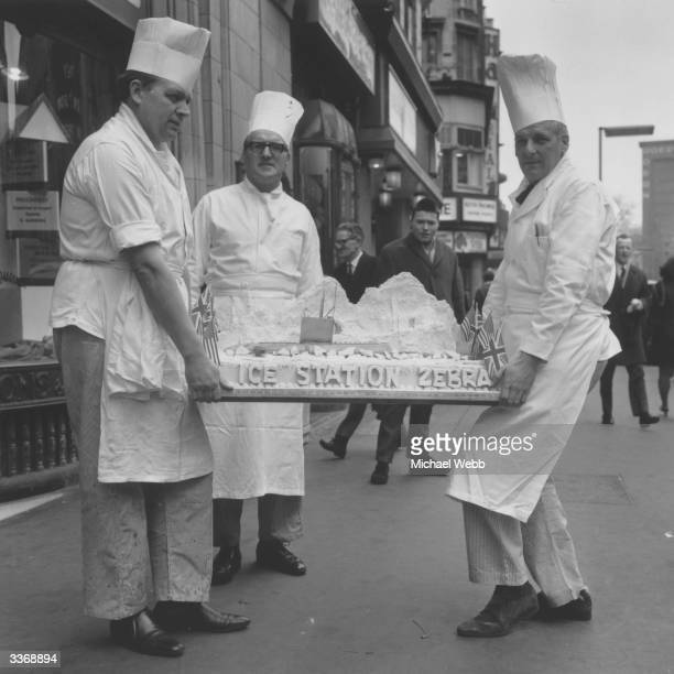 J Lyons' bakers Peterson Lynam and Brown with an 'Ice Station Zebra' cake for the premiere of the film of the same name