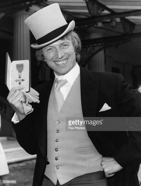 British entertainer Tommy Steele with his OBE award