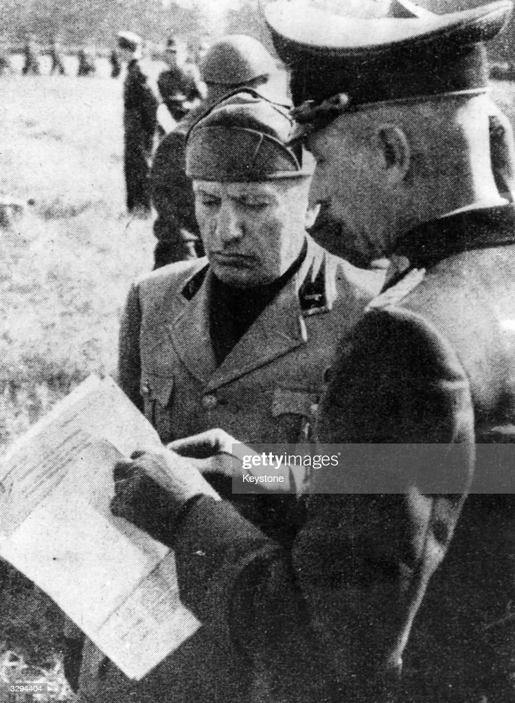 Former Italian dicatator Bernito Mussolini talks to a German general during his inspection of a newly-formed Italian (Fascist) division.