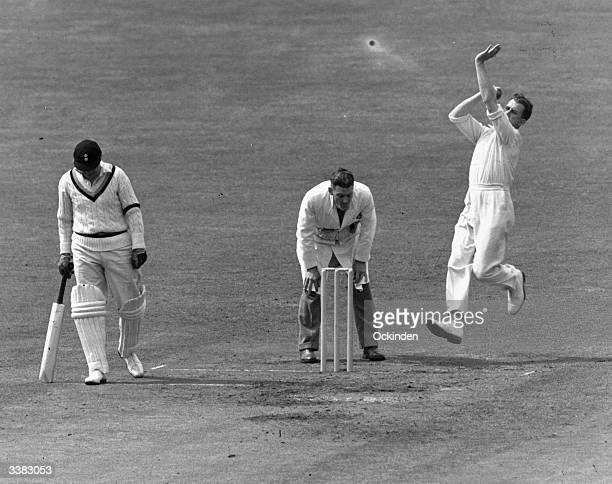 Surrey and England cricketer Jim Laker bowling against Derby at the Oval in Greater London