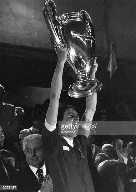 Liverpool captain Phil Thompson holds aloft the European Cup trophy after beating Real Madrid 10 in the European Cup final in Paris