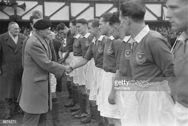 Portsmouth FC was formed in 1898 and celebrating its Golden Jubilee Field Marshal Montgomery who is President of the club greets the players before...