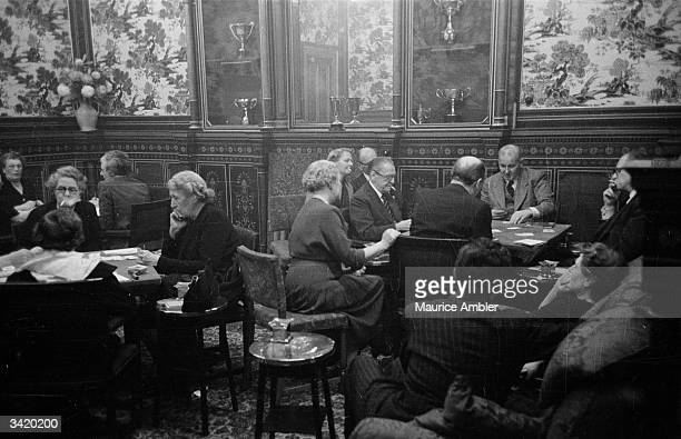 English novelist William Somerset Maugham is the guest of honour at a bridge party at Crockford's Club Original Publication Picture Post 6879...