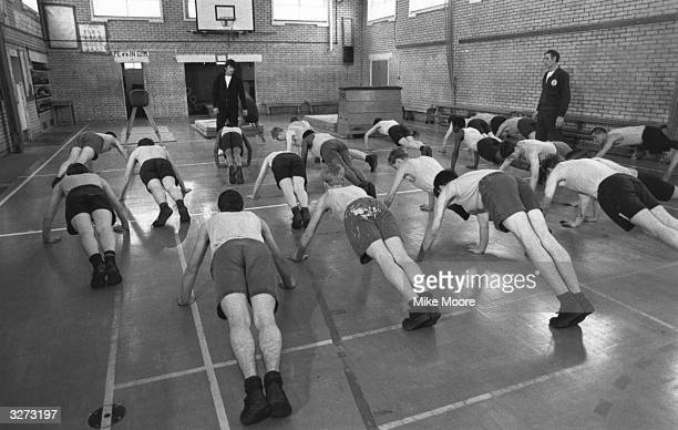 Young boys exercising in a junior detention centre at Send near Woking Surrey