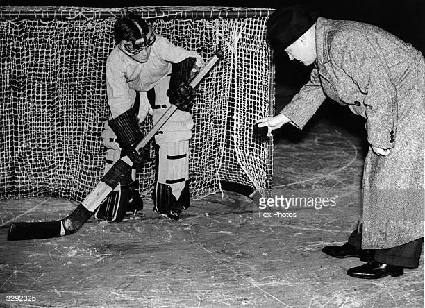 A Streatham schoolboy is taught the art of ice hockey goalkeeping at Earl's Court by Babe Donnelly the Canadian coach of the Earl's Court Rangers