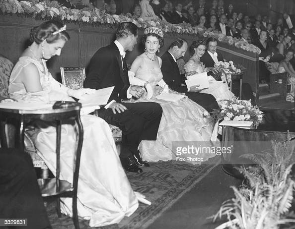 Queen Elizabeth II and the Duke of Edinburgh in the Royal Box at the Odeon Leicester Square London before the start of the Royal Film Performance of...