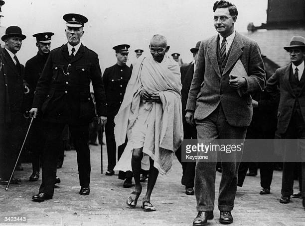 Indian thinker statesman and nationalist leader Mahatma Gandhi arriving at Greenfield Mills Darwin Lancashire during his tour of Britain